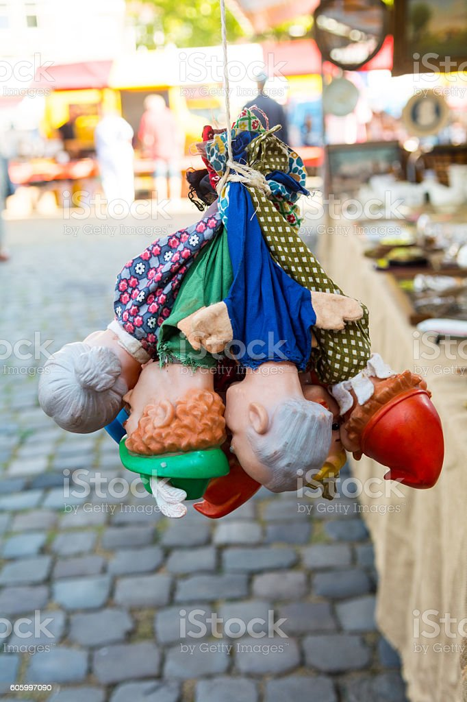 Punch and judy puppets bundle hanging on flea market stock photo