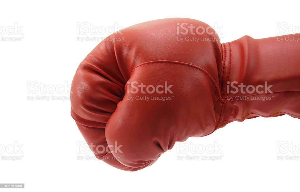 Punch by red boxing glove stock photo