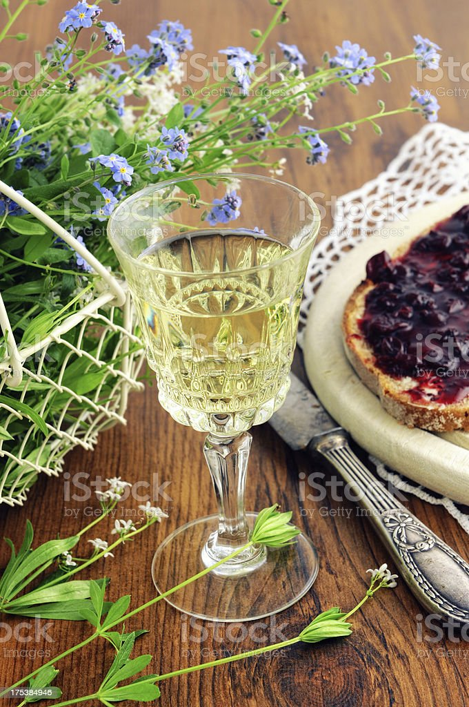 punch glass with table knifes bread jam and flowers stock photo