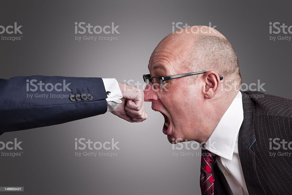 Punch on the nose royalty-free stock photo