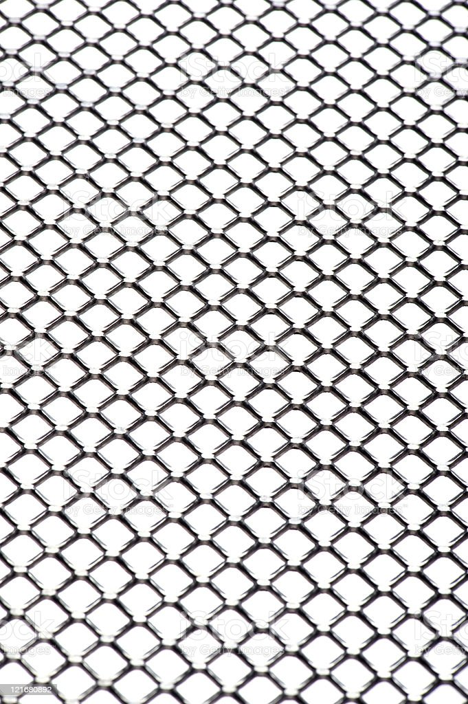 punched metal close up stock photo