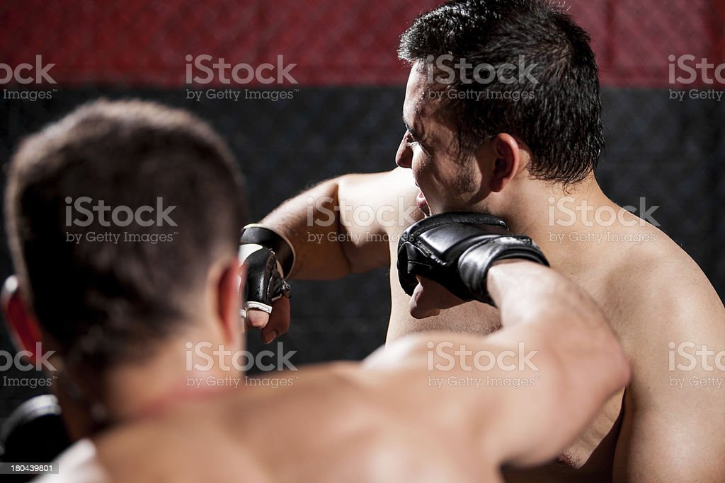 Punching an opponent during a fight royalty-free stock photo