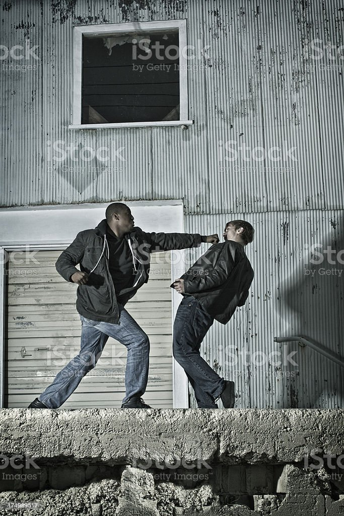 Punching and Backing Up in Kenpo Karate on the Street stock photo