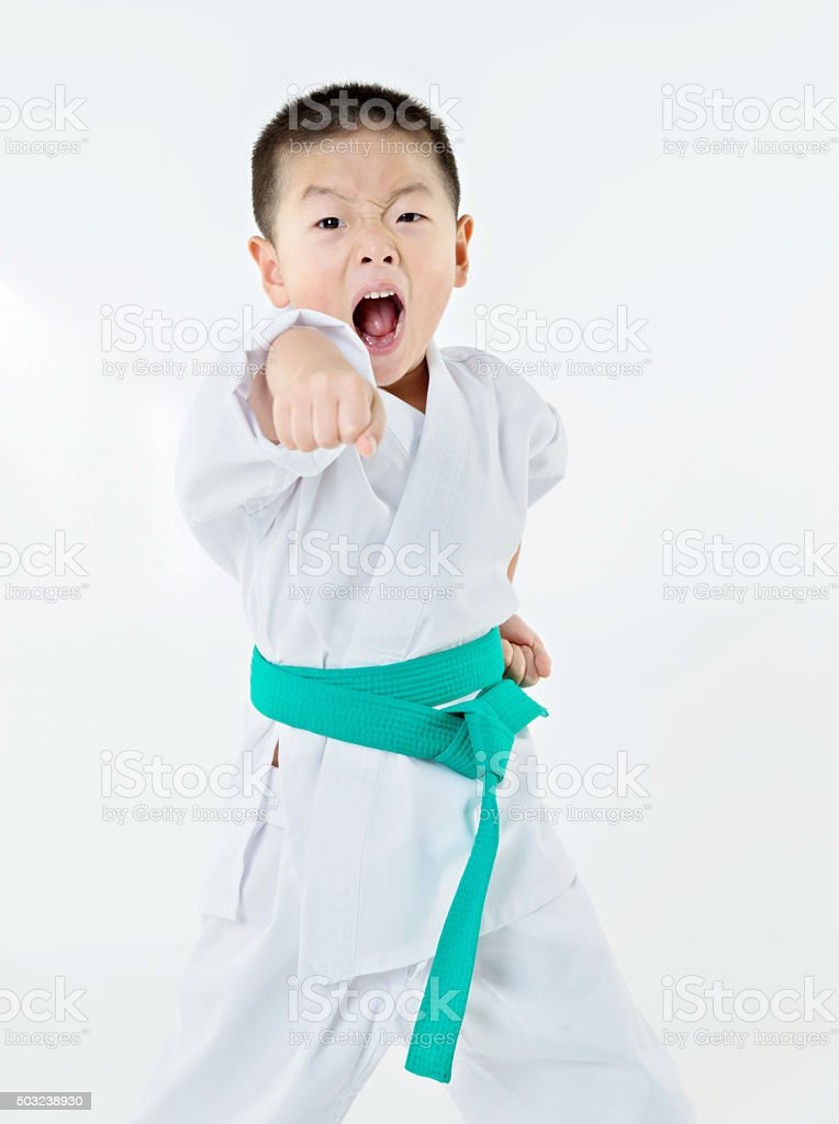 Punching boy stock photo