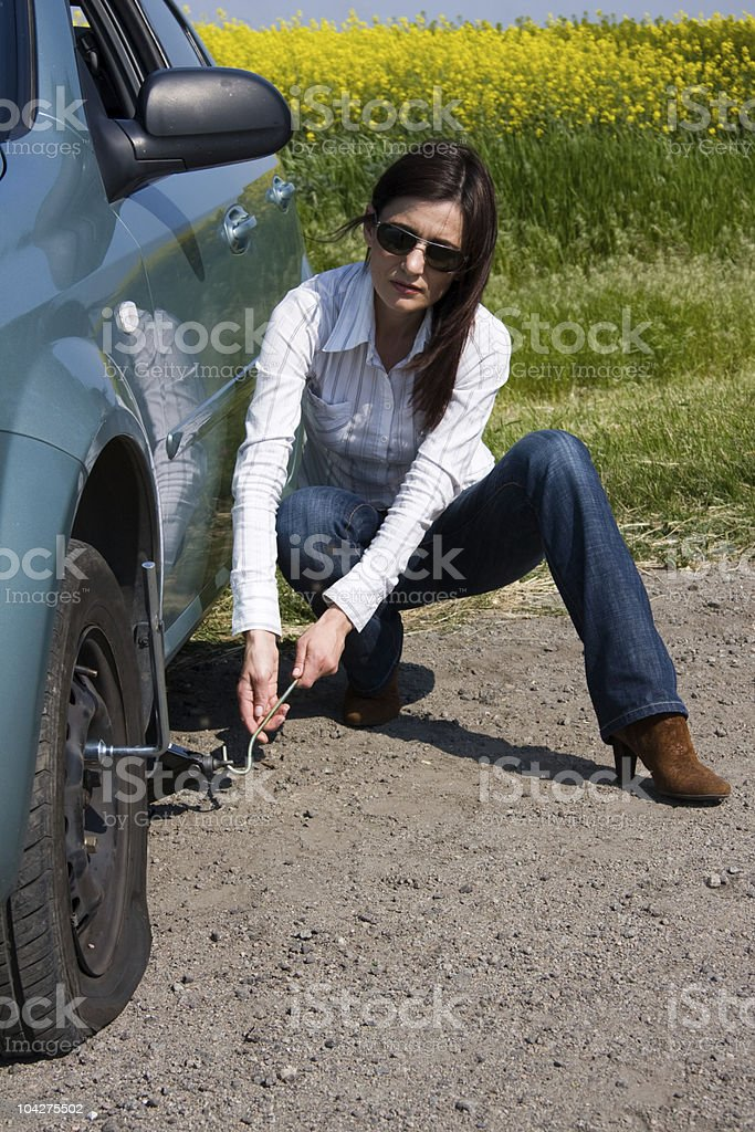 punctured wheel royalty-free stock photo