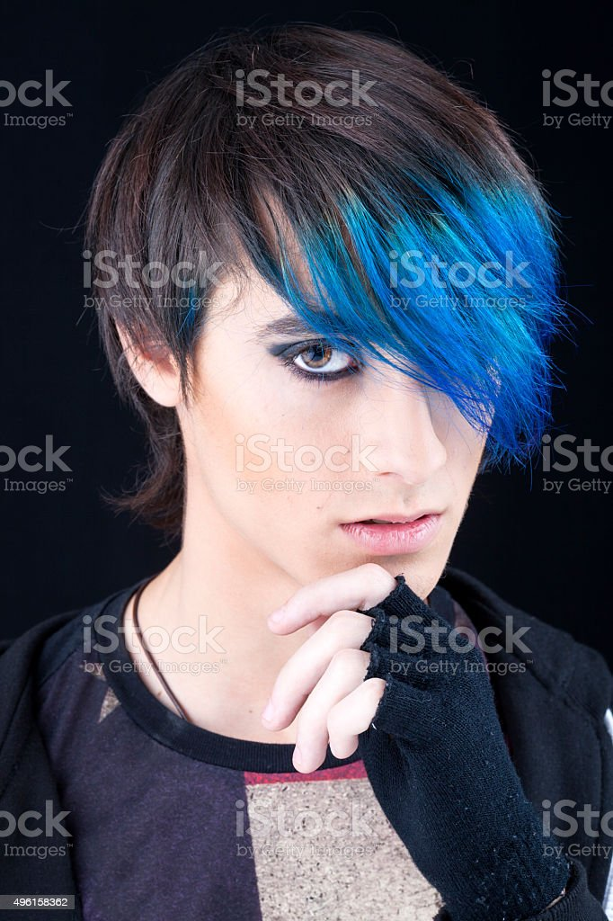 Punk boy with blue highlights in hair stock photo