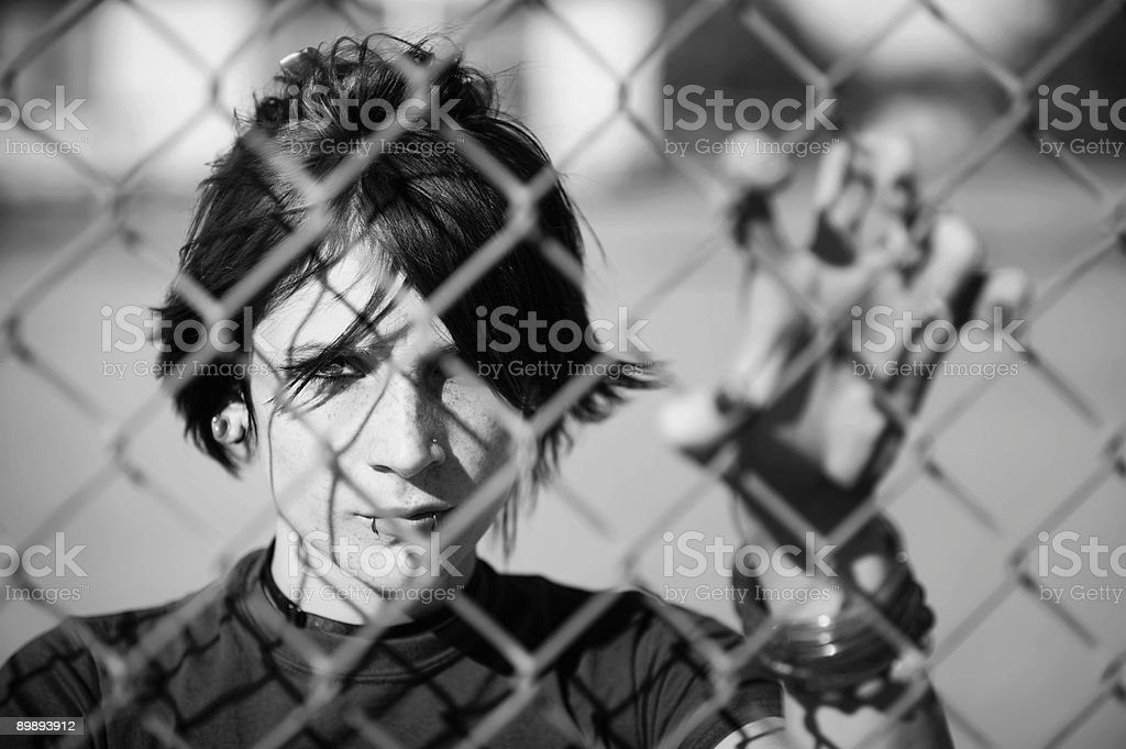 Punk Girl Behind Chain Link stock photo