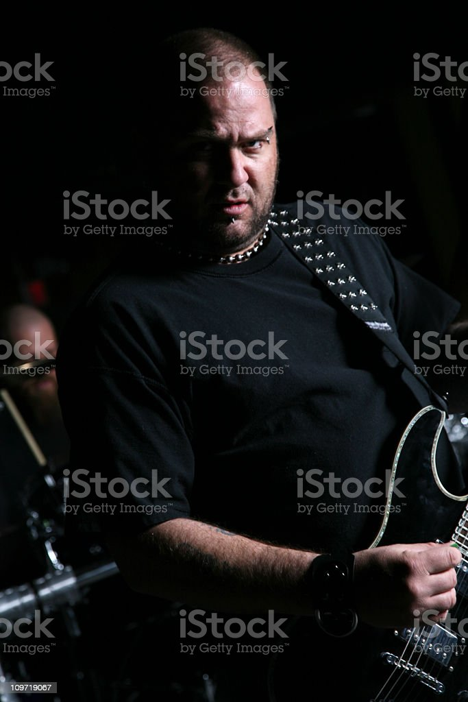 Punk Guitar Player Playing With His Band stock photo