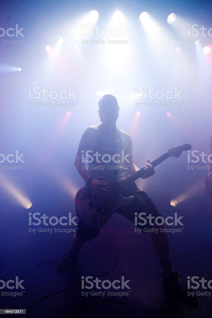 punk guitarist playing live stock photo