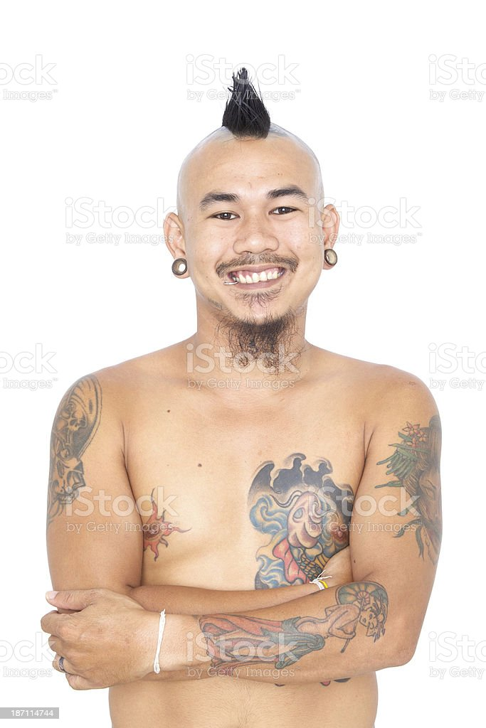 punk guy with mohawk hair style, piercing and tattoo royalty-free stock photo