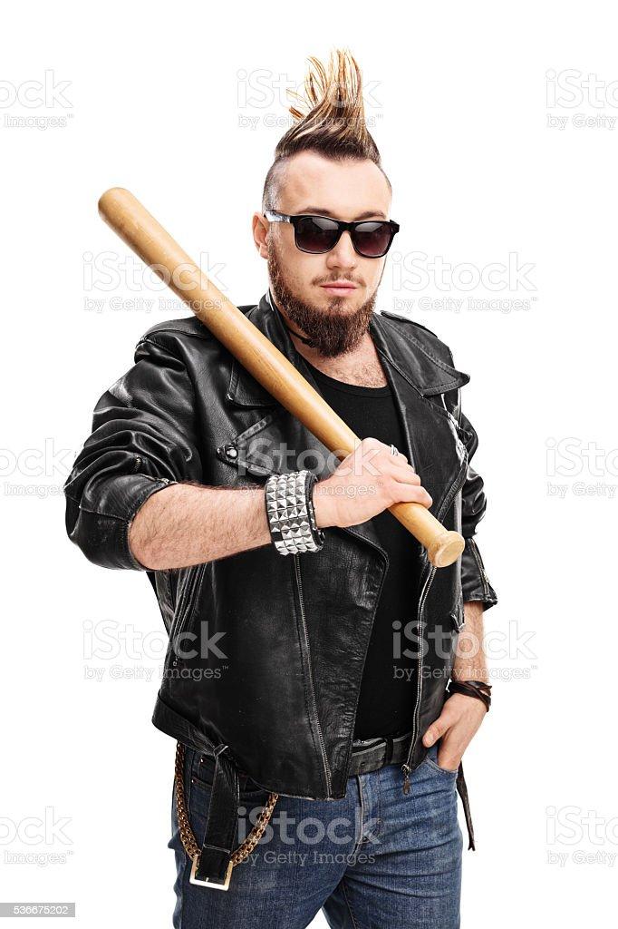 Punk holding a baseball bat stock photo