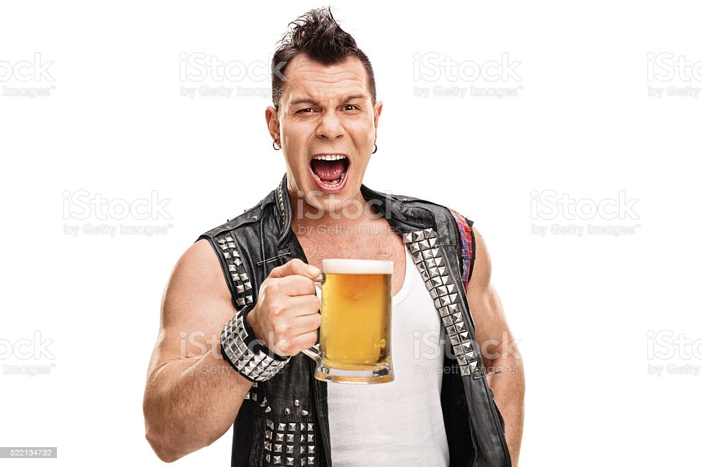 Punk in an old jacket holding a pint of beer stock photo