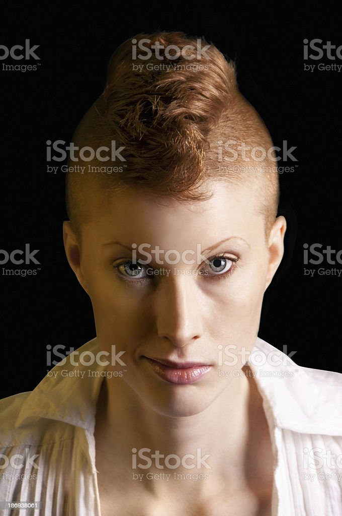 Punk redhead woman with mohawk shaved hairs and green eyes stock photo