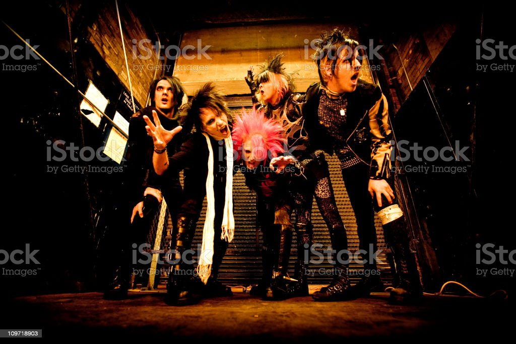 Punk rock goth band in a freight elevator stock photo