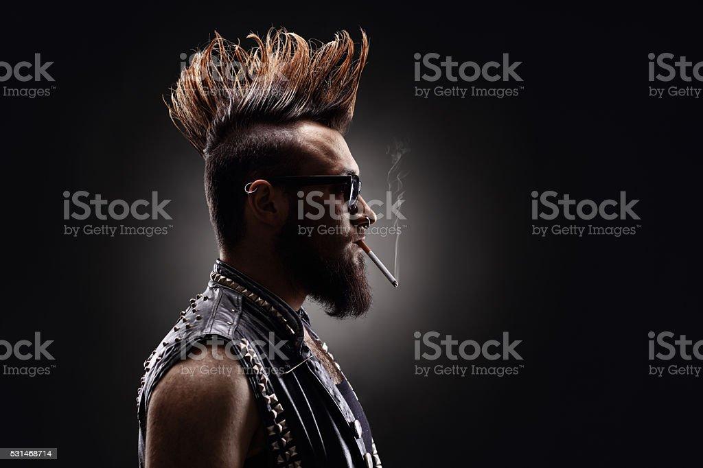 Punk rocker smoking a cigarette stock photo