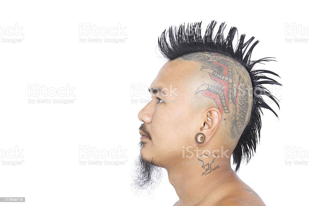 punk with mohawk hair style, tattoo on head, ear piercing royalty-free stock photo