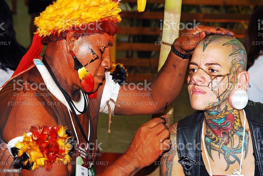 Punk woman having her face painted stock photo