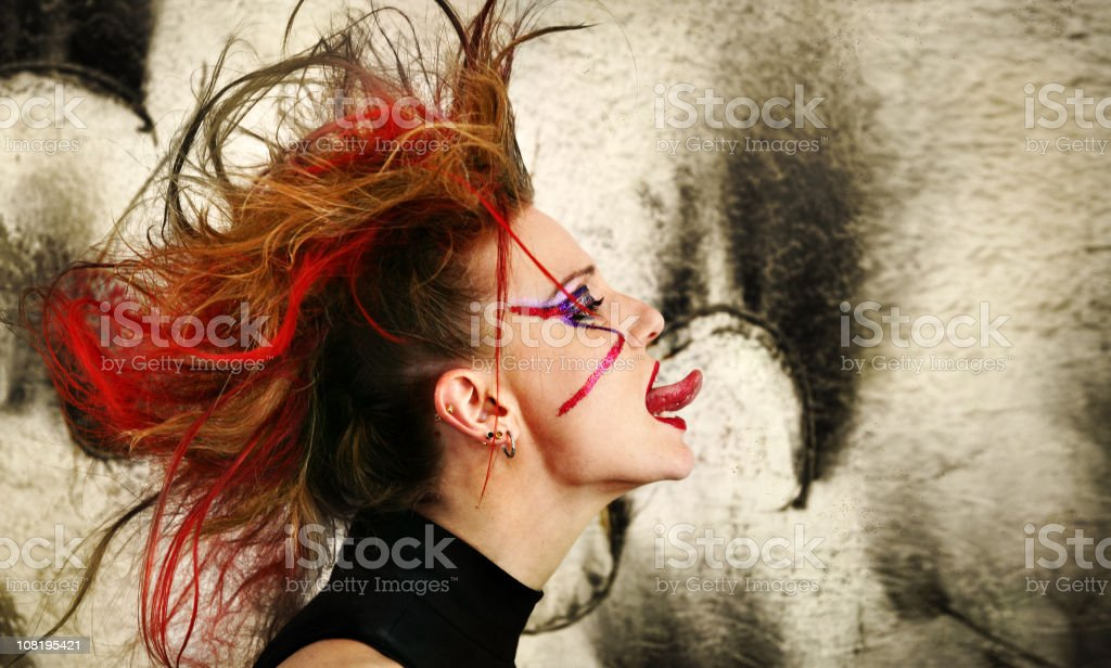 Punk Woman sticking tongue out royalty-free stock photo