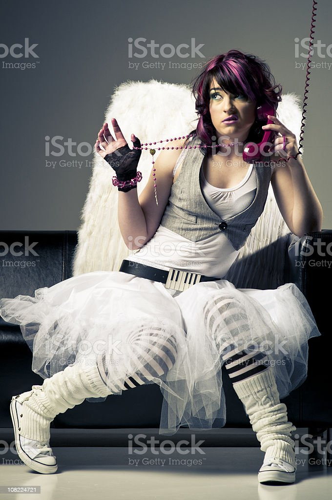 Punk Woman Wearing Angel Wings stock photo