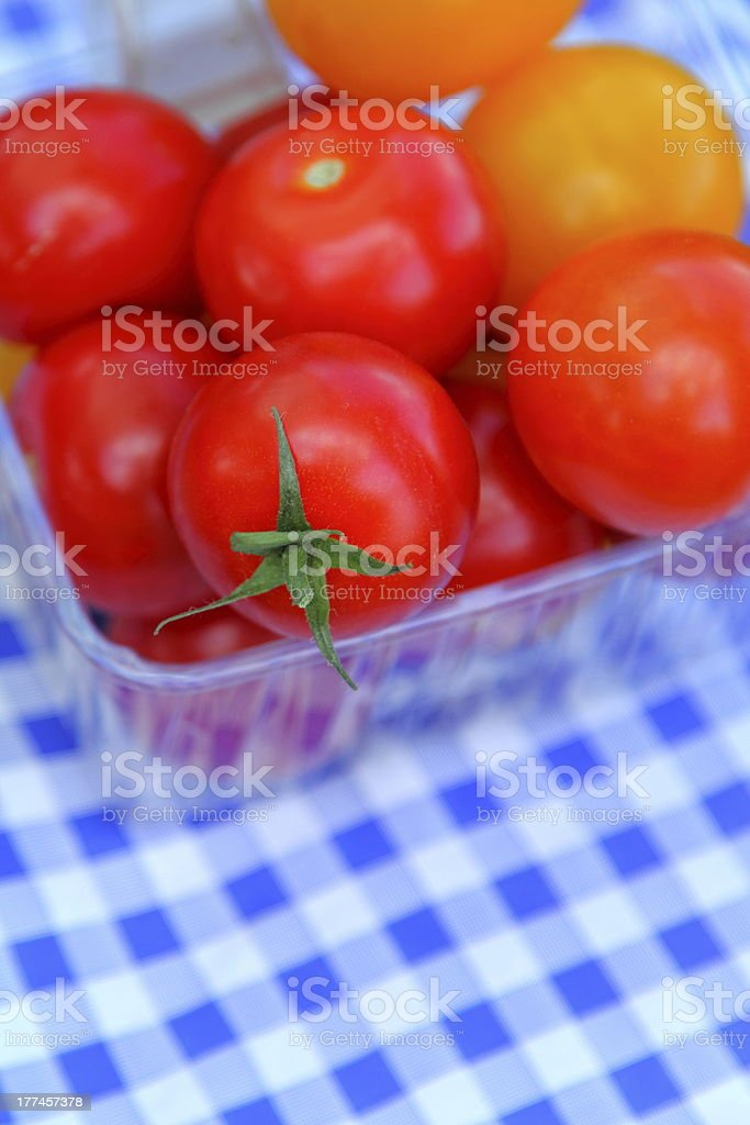 Punnet of Ripe Tomatoes royalty-free stock photo