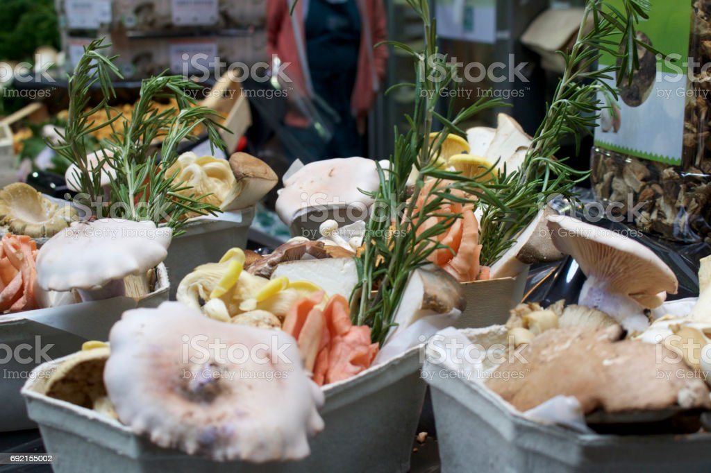 Punnets of mushrooms at a market stall stock photo