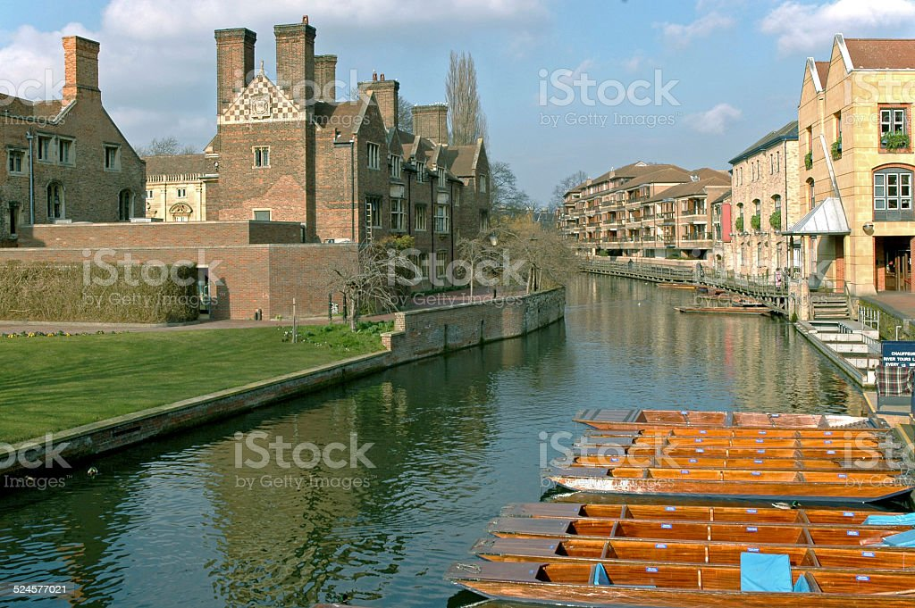 Punts on Cam River near Magdalene College in Cambridge UK stock photo