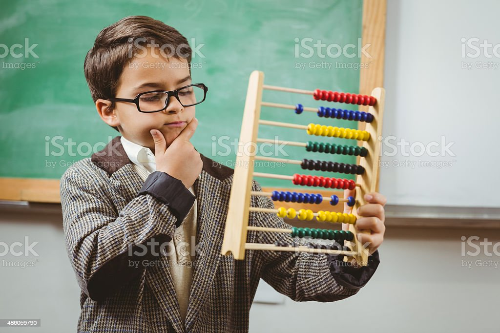 Pupil dressed up as teacher holding abacus stock photo