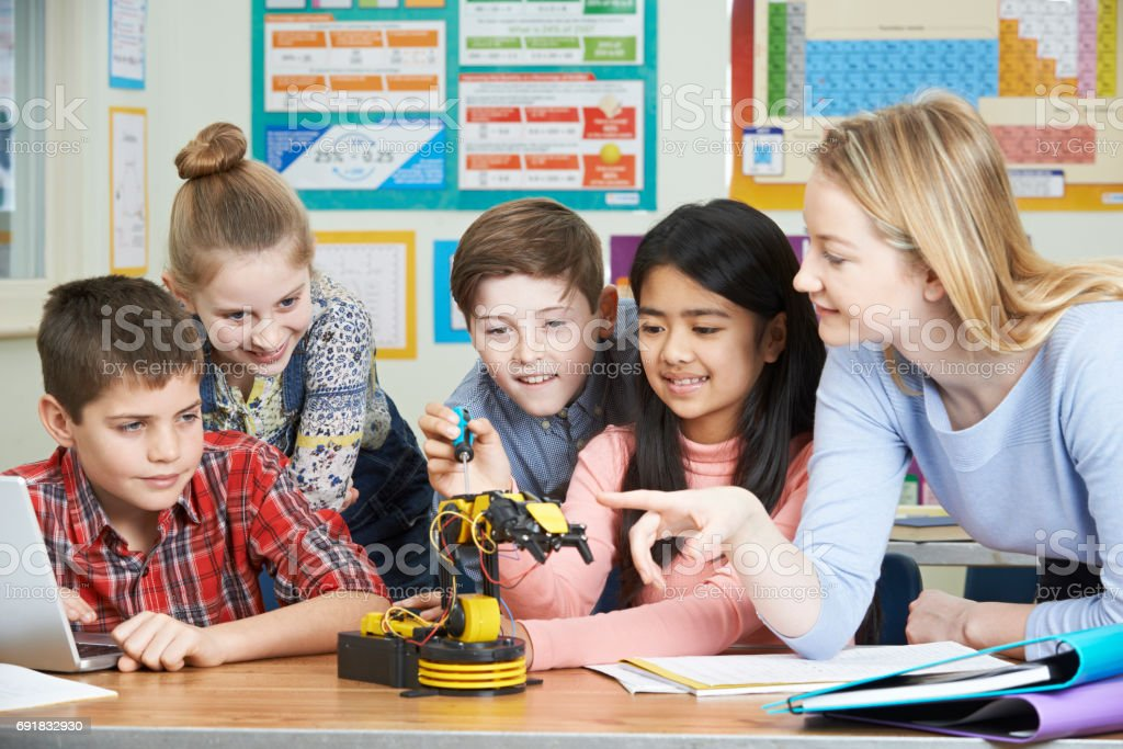 Pupils And Teacher In Science Lesson Studying Robotics stock photo