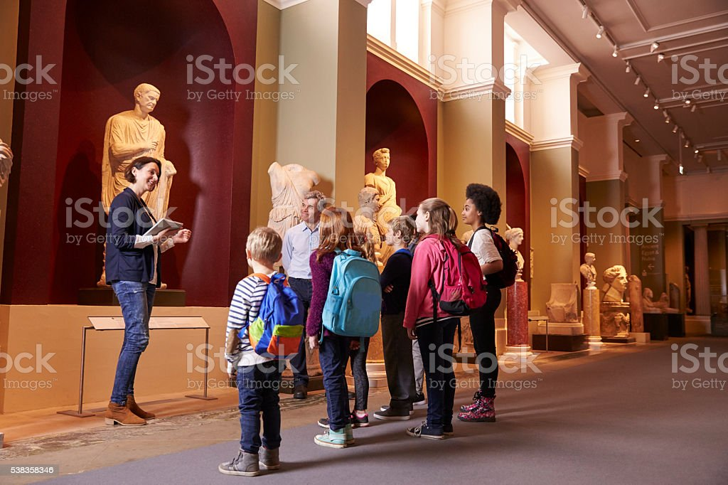 Pupils And Teacher On School Field Trip To Museum stock photo