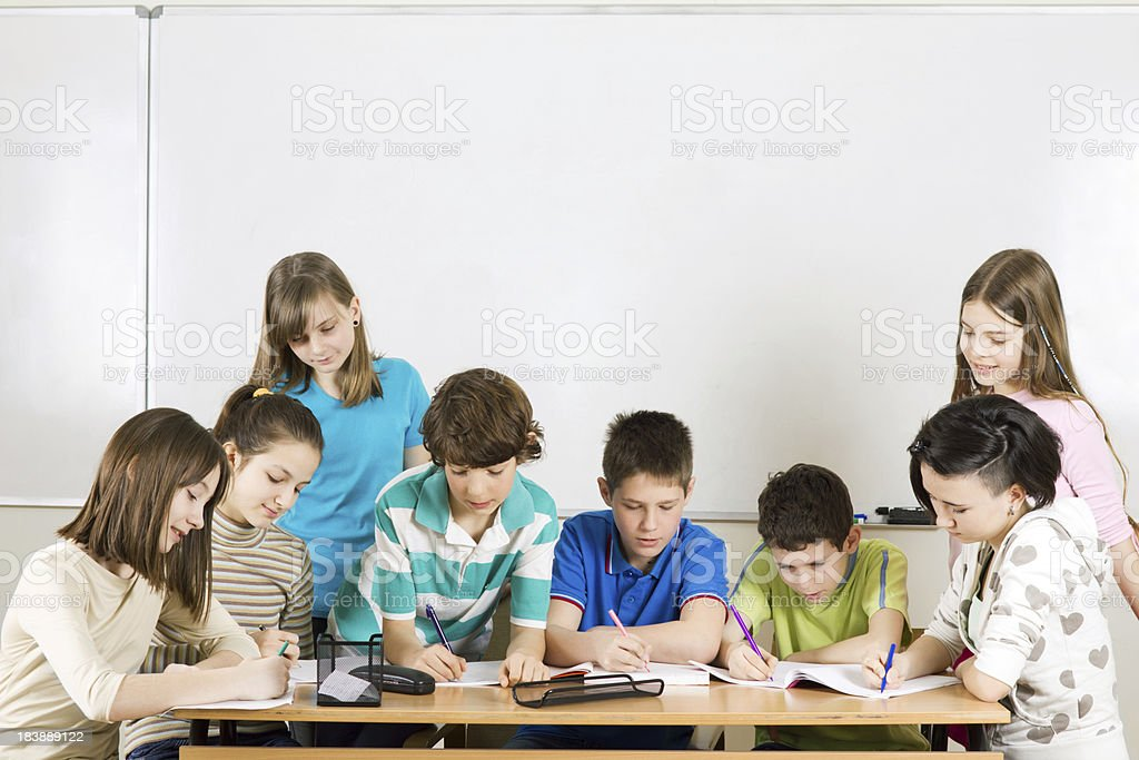 Pupils doing teamwork. royalty-free stock photo