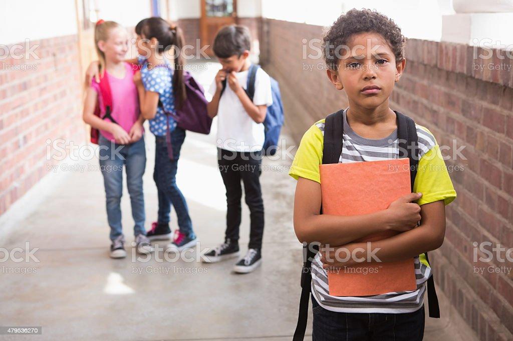 Pupils friends teasing a pupil alone stock photo