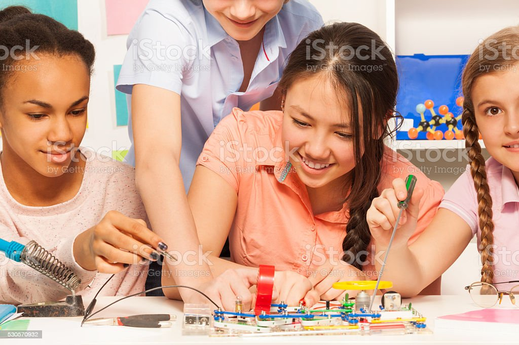 Pupils learning physics, assembling electric chain stock photo