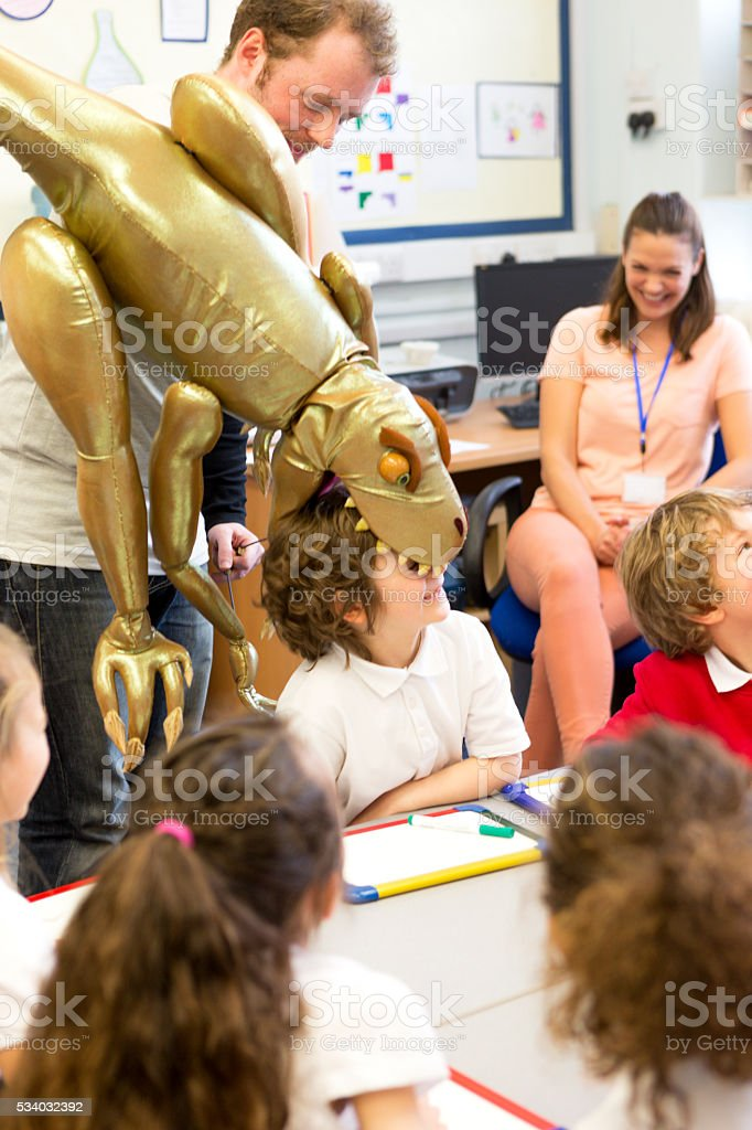 Pupils learning through puppets stock photo