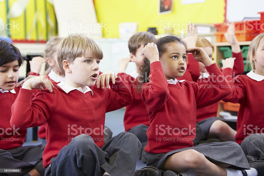 Pupils Perfoming Actions Whilst Singing Song stock photo