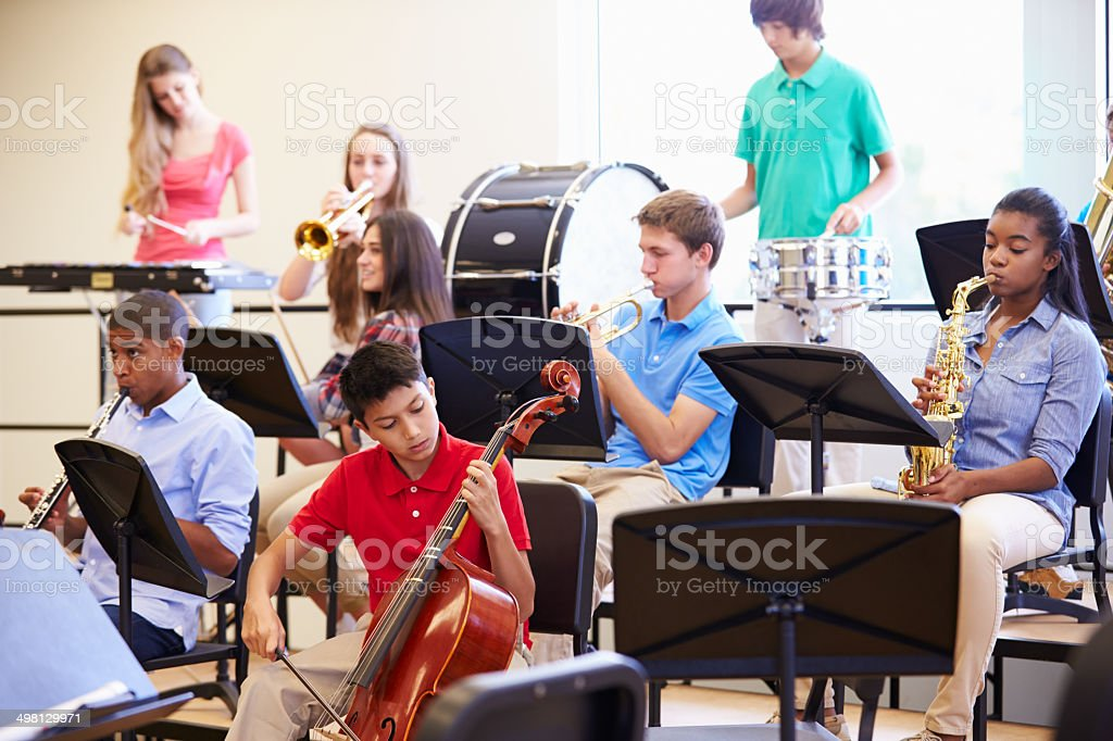 Pupils Playing Musical Instruments In School Orchestra stock photo