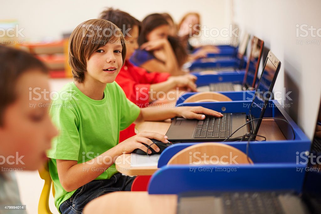 Pupils sitting at the computer science lesson stock photo