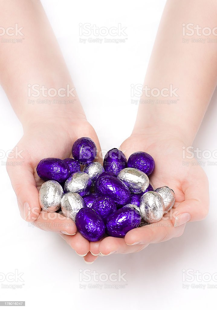 Puple and silver Easter eggs in hands royalty-free stock photo