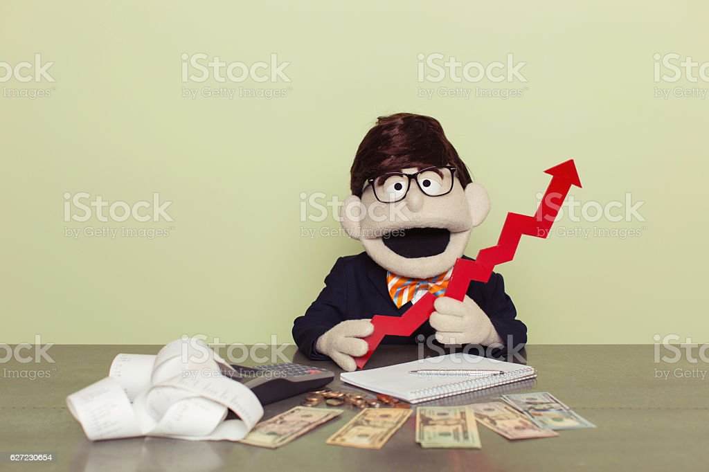 Puppet Accountant Holds Red Line Graph stock photo