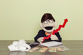 Puppet Accountant Holds Red Line Graph