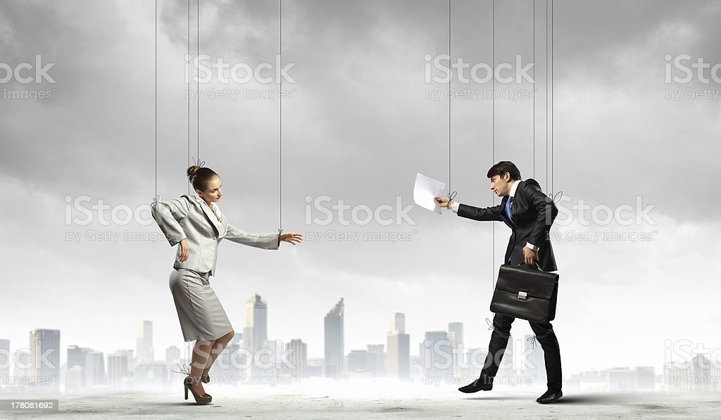 Puppet businesspeople royalty-free stock photo