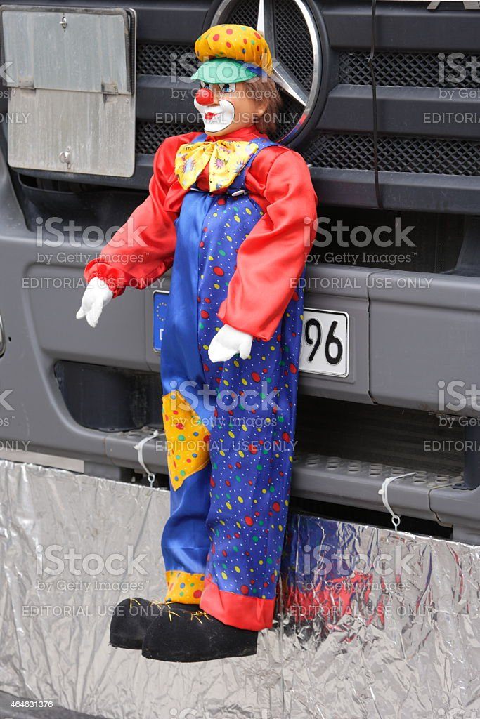 puppet hanging on front of parade truck stock photo