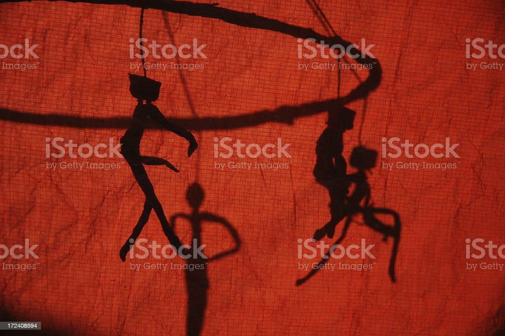 Puppet shadow behind a red curtain stock photo
