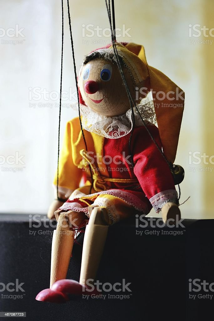 Puppet sitting in the sun royalty-free stock photo