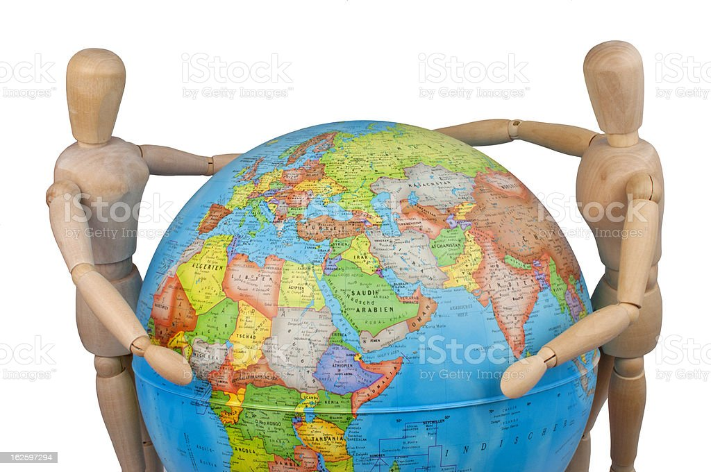 puppets embracing globe royalty-free stock photo