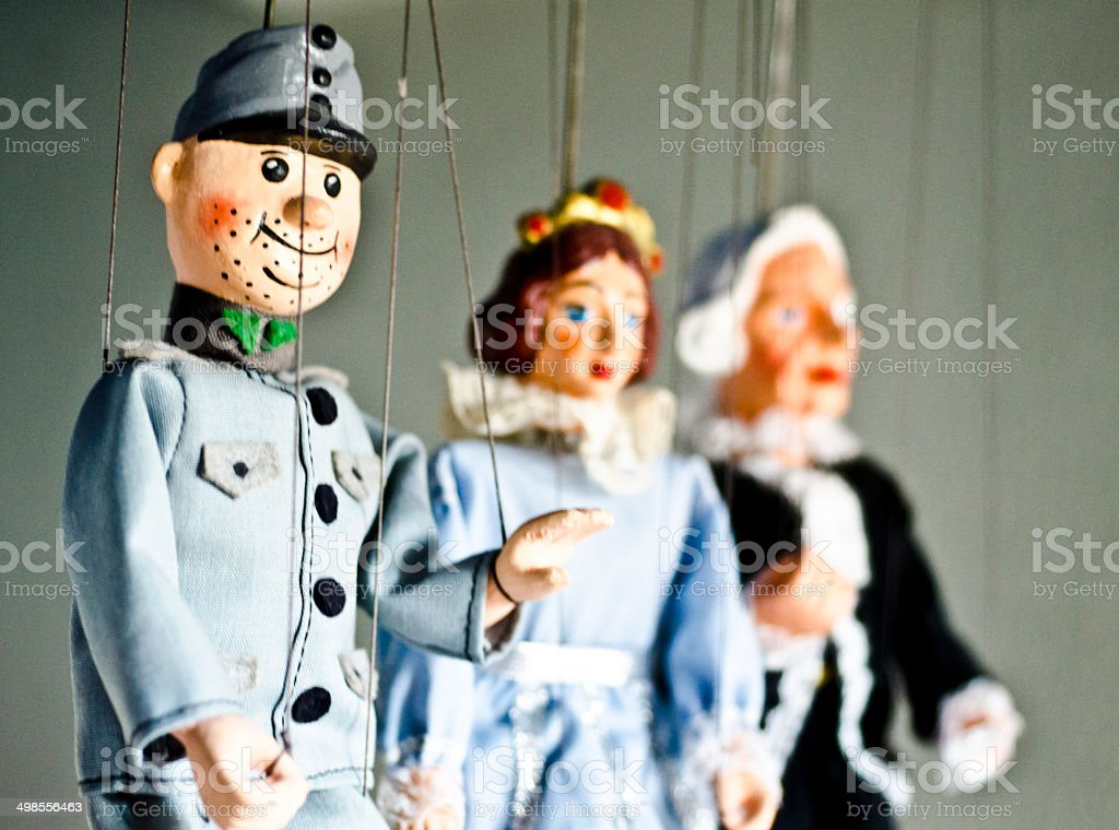 Puppets on a string stock photo