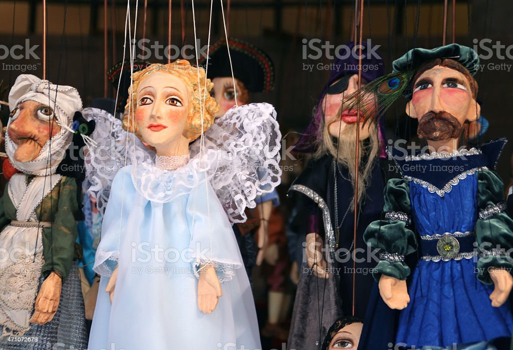 Puppets on strings stock photo