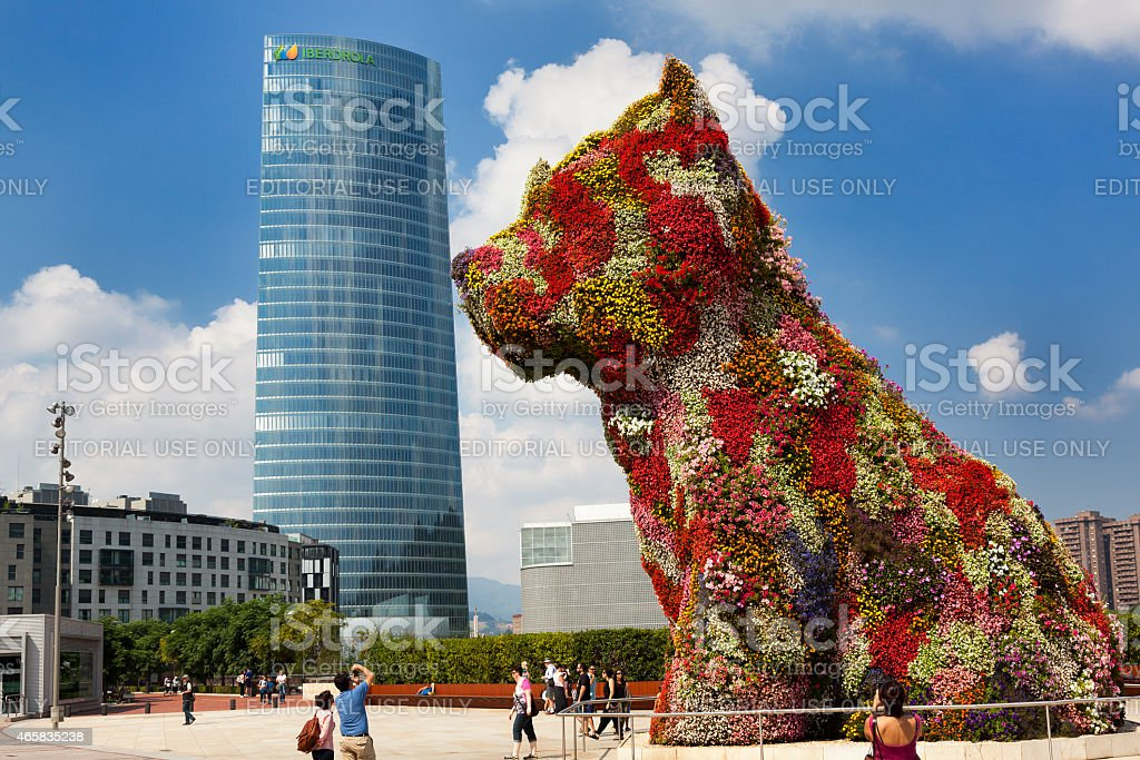 Puppy kissing the Iberdrola skyscraper stock photo