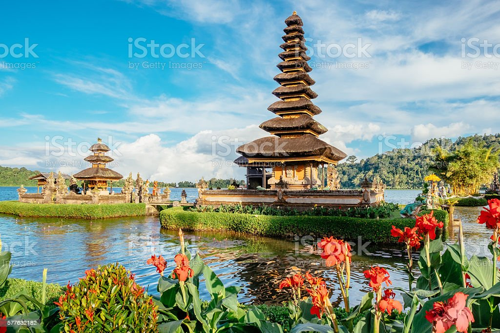 Pura Ulun Danu Bratan, Hindu temple surrounded by flowers stock photo