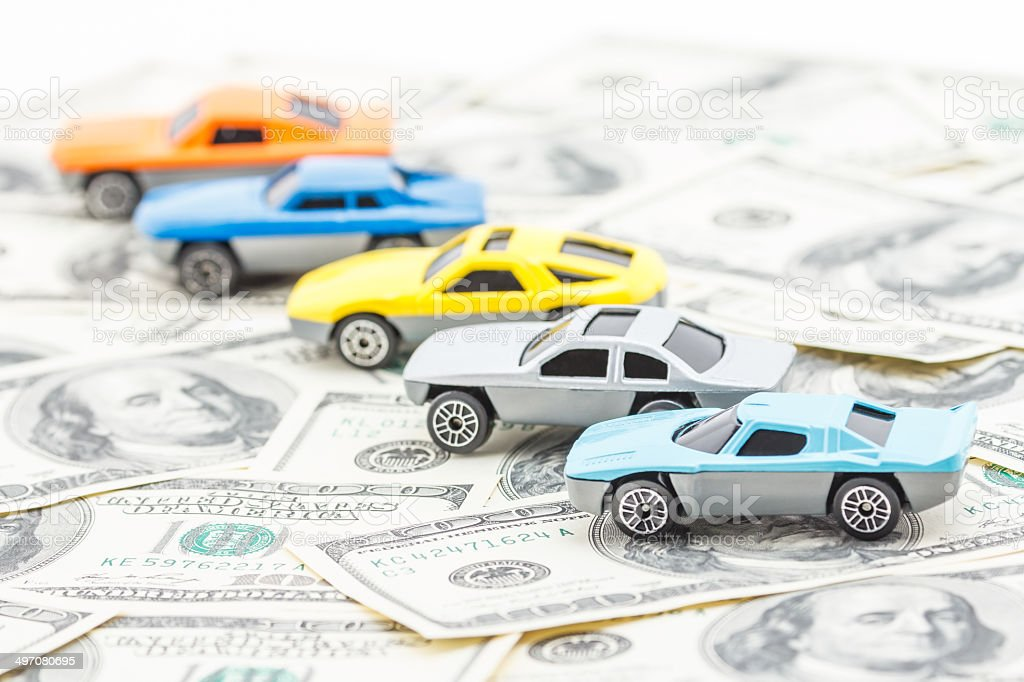 Purchase and sale of cars by money. stock photo