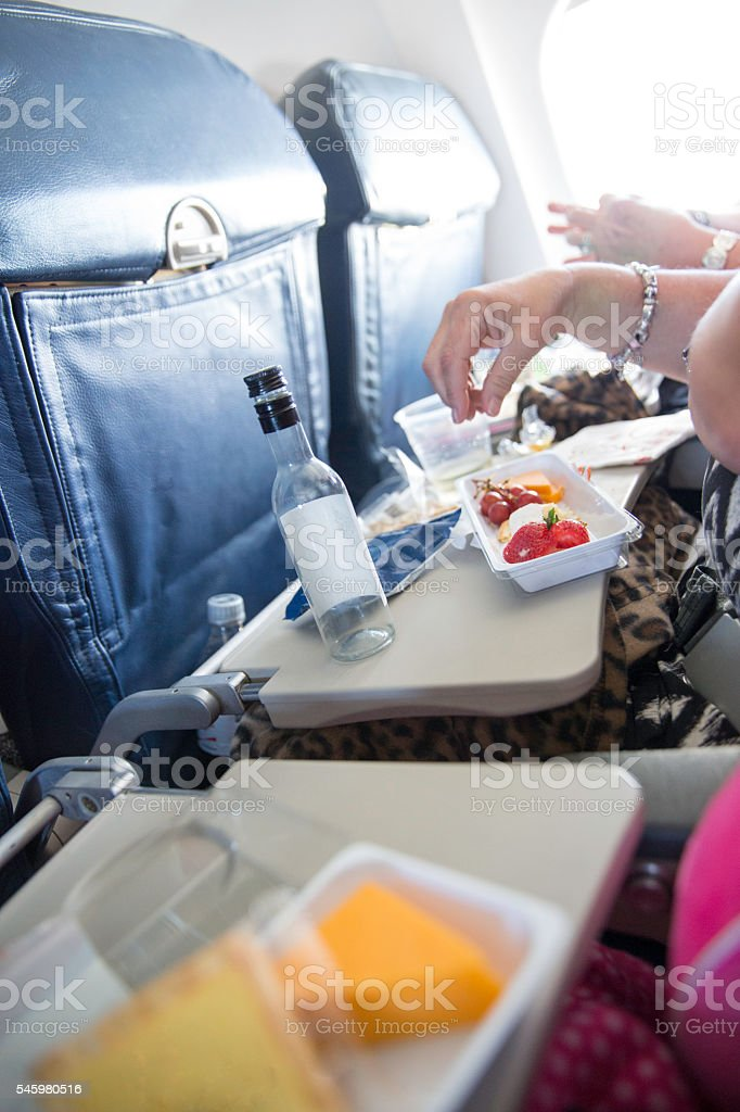 Purchased airplane food on tray in airplane stock photo